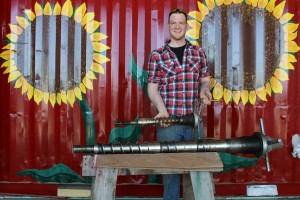 Wade Mahoney, with oil press augers.