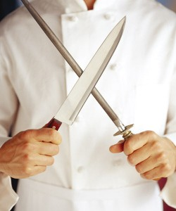 chef with knife and steel