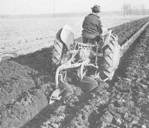 Man on Ford tractor